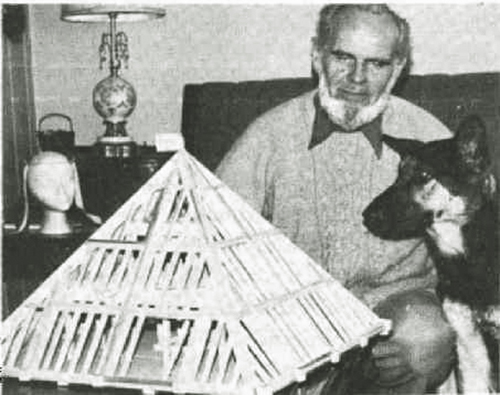 Les Brown with model pyramid and his dog