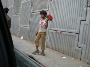 A boy selling flowers - Educate | Itsfacile