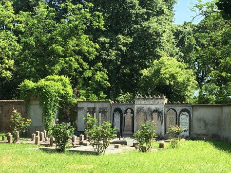 Elegant temples and tombs line the walls in the Jewish Cemetery