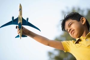 Best Toys without Batteries, boy playing with airplane