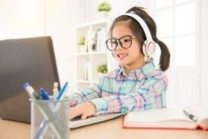 Favorite Free Homeschool Curriculum, girl at computer with headphones