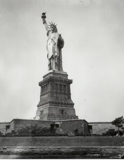 """""""Liberty Enlightening the World"""" in 1930's New York Harbor. Photograph of the Statue of Liberty, 1930. From the Records of the Office of the Chief Signal Officer. National Archives Identifier: 594414"""