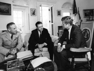 John F. Kennedy meeting with Secretary of Defense Robert S. McNamara and Chairman of the Joint Chiefs of Staff General Maxwell D. Taylor
