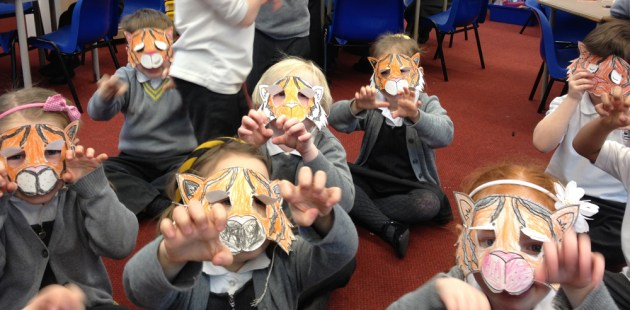 Children wearing tiger masks