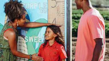 Image showing parents measuring the height of their child