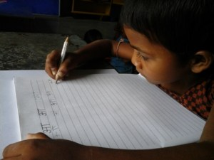a-child-writing-in-class-one