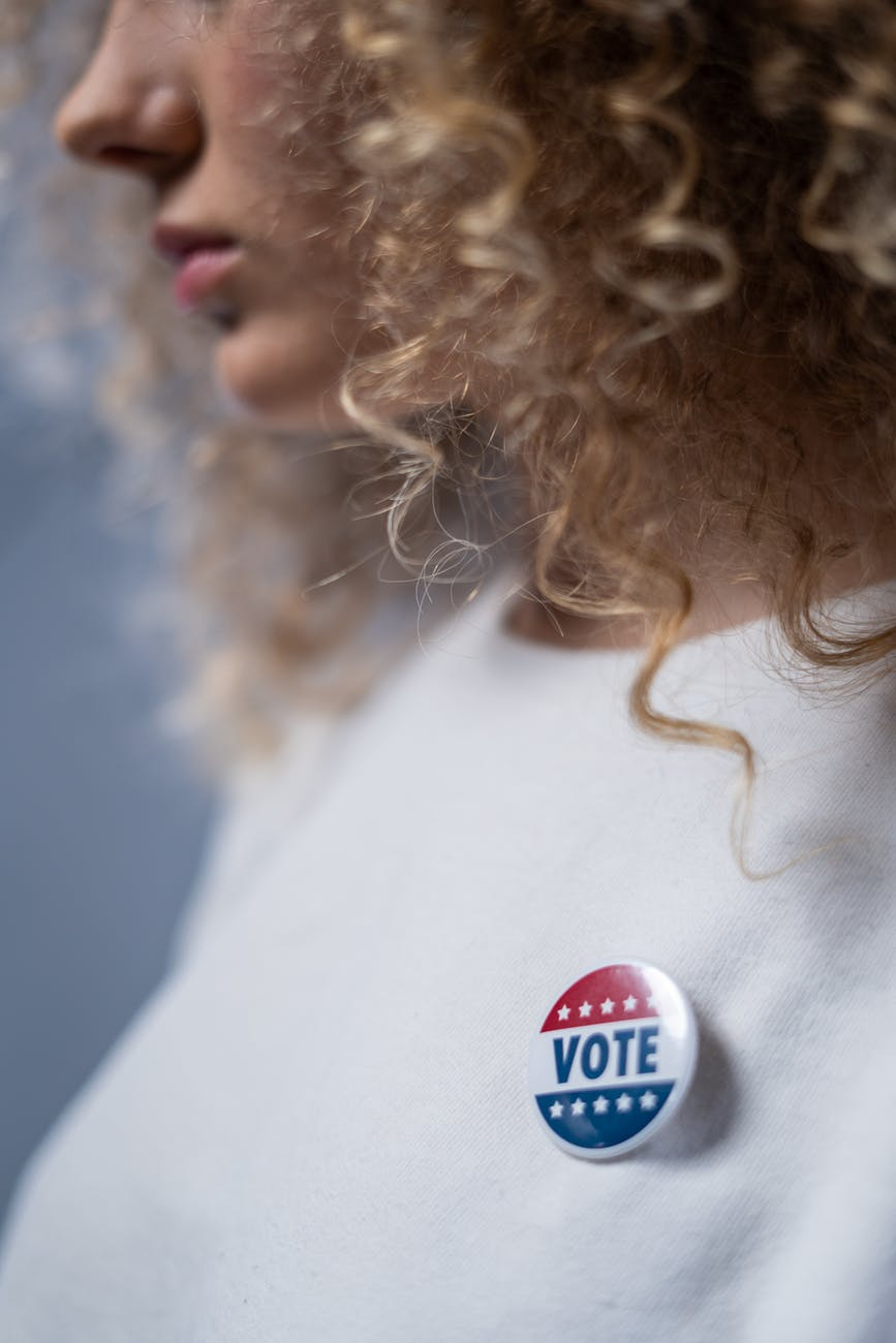woman with a vote pin