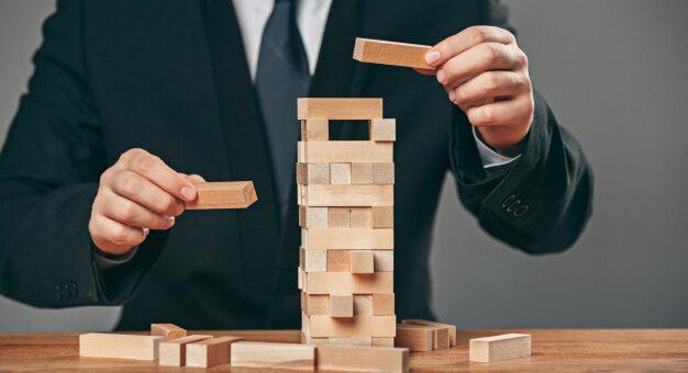 man-wooden-cubes-table-management-concept_155003-10330