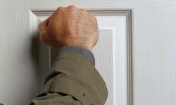 hand knocking on door