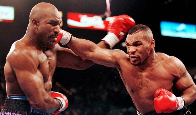Mike Tyson and Evander Holyfield exchange pleasantries, 1996.