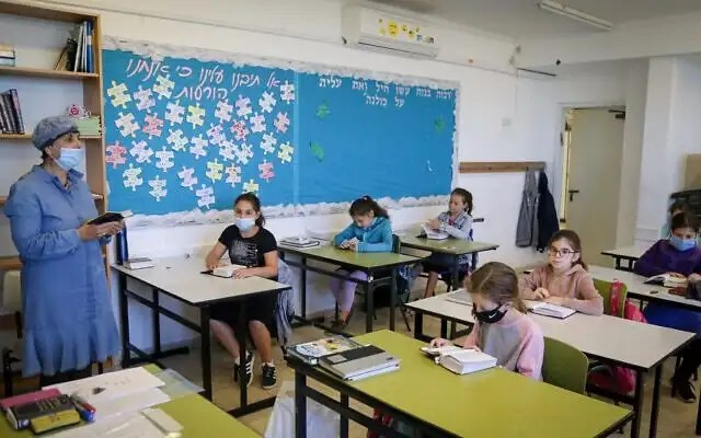 Physical distancing and wearing of protective face masks at the Orot Etzion school classroom in Efrat, Israel as a safety measure to curb the spread of coronavirus among school children.