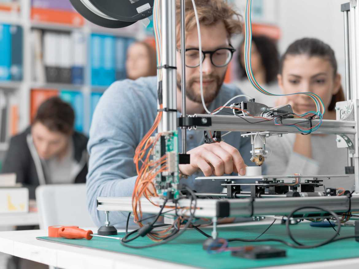 Students using a 3D printer