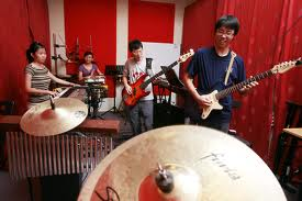 Music students having their music recorded by Mass Comm students in the professional recording studio at UCSI University