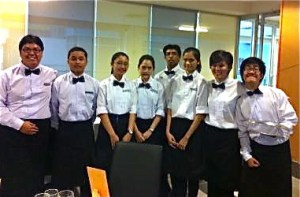 Ready to serve: Niroshen (fourth from right), Jen Nee (fifth from right) and Maverick (right) joined the other HELP CAT students to serve the guests.