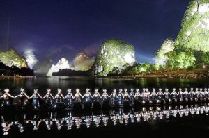 A scene from the Impression Liu Sanjie outdoor musical in Guilin, which features dazzling light effects and an awesome setting of mountains and a river.