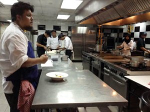 Chef Darren Teoh briefing the culinary students before service