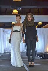 UCSI University fashion student Worood Abdul Karim (right) and her model greeting the audience at the end of the bridal competition cum exhibition