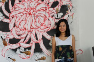KBU International College's Graphic Design alumni, Yong Vin Sze with the graphic installation