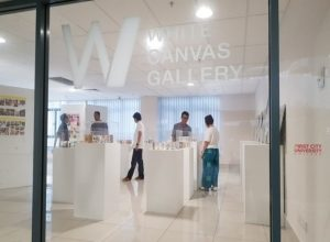 White CanvasGallery showcasing design students' artwork at First City University College