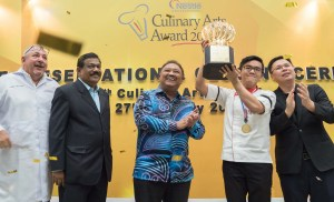 Taylor's University Culinar Arts Student, Edward Eng Sheng Pei with his winning trophy and medal