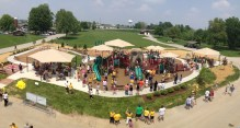 Arial image of numerous children and adults playing on the new boundless playground