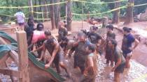 Udder Mud Run: We each had to support each other as we slid up and over the slides to move through the course.