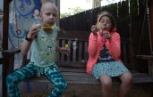 Harmony Mosier and Cali Pennell blow bubbles in the Mosier family's backyard in Phoenix, Arizona on April 20, 2017.