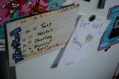 Handmade get well drawings and positive messages hang from the Mosier family's refrigerator.