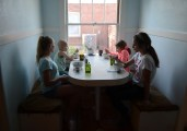 Harmony, Eleri, Cali, and Cali's sister Maddy Pennell, eat dinner.