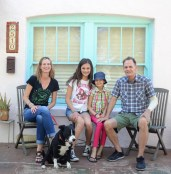 The Mosier family and their dog Oreo pose for a photo in front of their home in the Coronado Historic District in Phoenix.