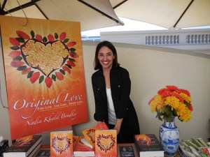 "Author Nadia Khalil Bradley with her motivational book ""Original Love"""