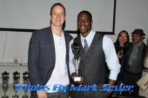 Jesse Mogle with award recipient and TV host H.R. Cole. Photo courtesy of Mark Sevier