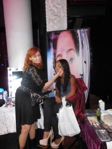 Makeup artist Victoria Rowe gives actress Candy Washington a quick makeover. Photo courtesy of Vida G.