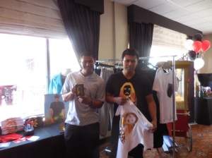 Eric and David Munoz of M the Movement hold up some cool T-shirts from the line