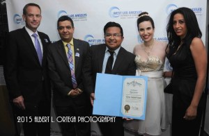 Vida receives her commendation from the West Los Angeles Chamber of Commerce. From left to right: Vice President Steve Little, President Roozbeh Farahanipour, Phil Bennett of the City of Los Angeles, Vida, and Elham Yaghoubian, human rights activist, author and handbag designer, and Board Member of the Chamber at the Ceremony. Photo courtesy of Albert L. Ortega/GettyImages.