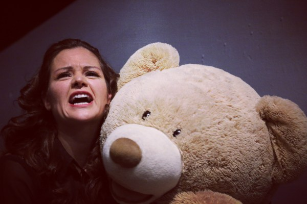 Vanessa sharing a moment with her teddy bear in American Man Dream. Photo by D Brown