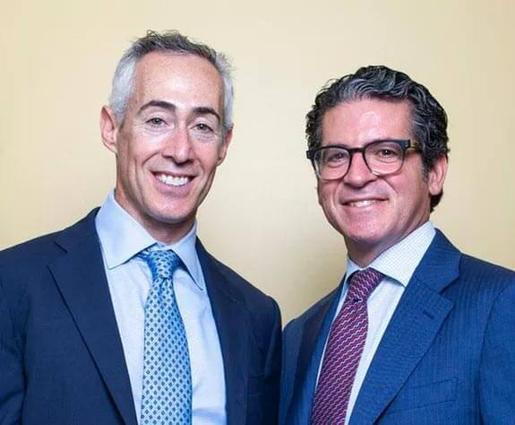Jay Freiberg and Howard Elman with slight smiles wearing business suits - NYC professional malpractice defense