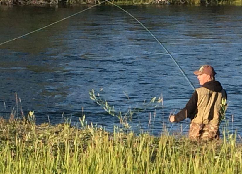 Fly fisherman by Yukon River