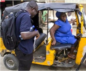 Olayinka Adeyemo: The heavily pregnant Keke driver working to feed her Family (Photo)