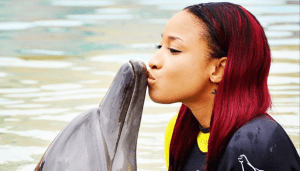 Tonto Dikeh gives the Dolphin a Cute Kiss (Photo)