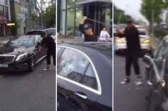 Bizarre: Man smashes his £150k Mercedes with golf club just because it BROKE DOWN (Video)