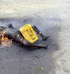 burnt-people-in-mile-12-riot-2