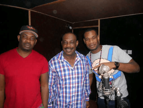 Collins Enebeli (Centre) with sons, Don Jazzy (R) and D'Prince