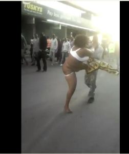 Say What! Woman strips naked to fight a man in Kenya (Photos)