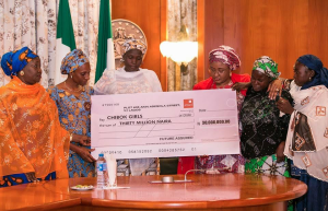 Aisha Buhari presents cheque to Chibok girls and Buni Yadi Boys Family1