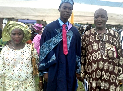 Michael Arowosegbe with his parents at the convocation