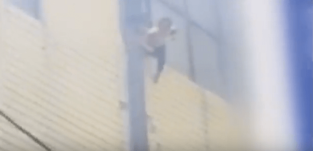 Mother and her 3 kids jump from burning building1