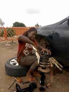 Abuja lady turns into full time mechanic after secondary school to make a living (Photos)