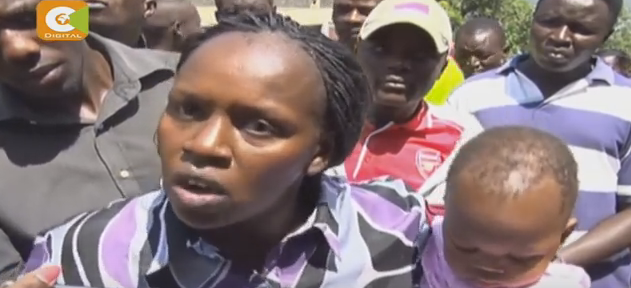 Angry Kenya woman destroy her husband's car over cheating1