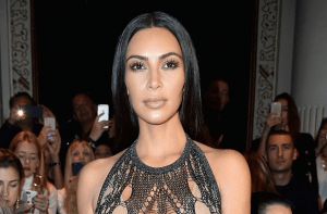 Check on Kim Kardashian's outfit at Balmain SS17 Paris Fashion Week show (Photos)